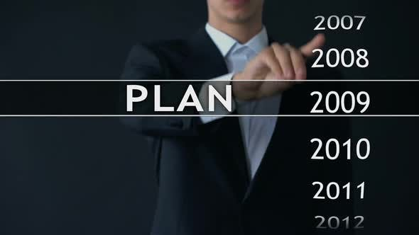 Thumbnail for Plan for 2014, Businessman Chooses File on Virtual Screen, Startup Strategy