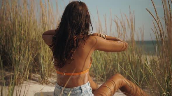 Boho Woman on the Beach Near the Sea
