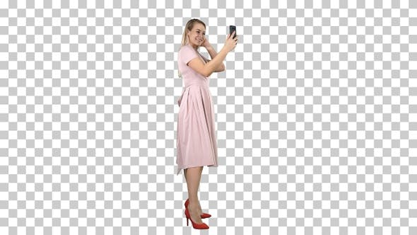 Thumbnail for Beautiful woman preen looking to her phone, Alpha Channel