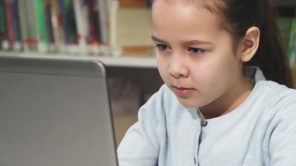 Thumbnail for Cute Little Girl Concentrating Using Her Laptop