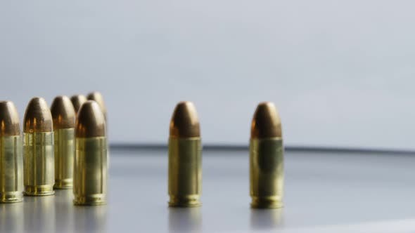 Cinematic rotating shot of bullets on a metallic surface - BULLETS 028