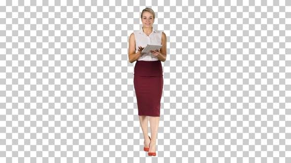 Smiling businesswoman using electronic tab swiping