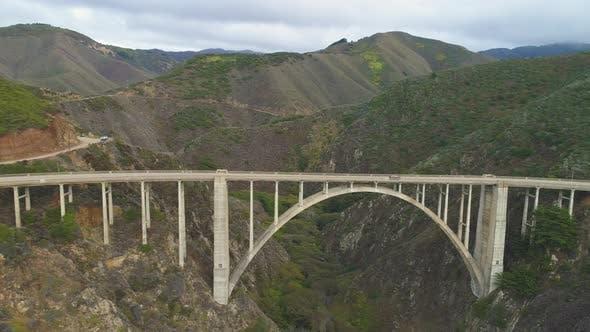 Cars on Bixby Creek Bridge. Big Sur, California, USA. Aerial View