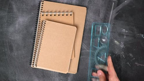 stack of notebooks with blank sheets