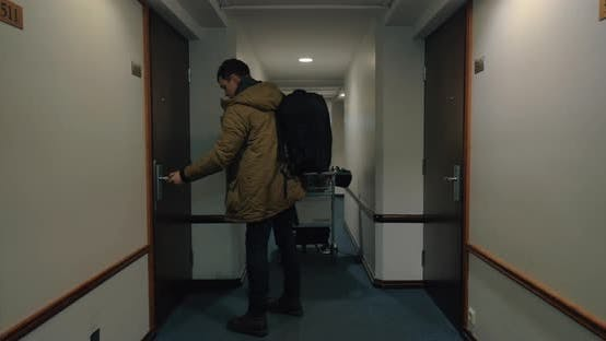Cover Image for Man Leaving Hotel Room