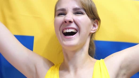 Thumbnail for Swedish Young Woman Celebrating while Holding the Flag of Sweden