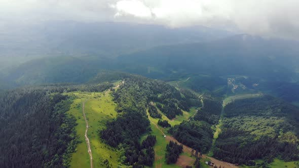 Aerial Drone View: Fabulous View of the Carpathian Mountains in Ukraine. The Mountain Tops Are