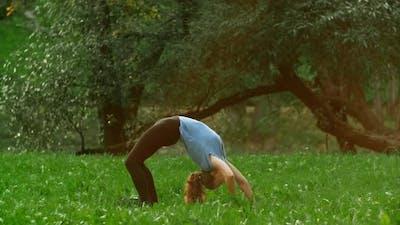 Sport Woman in Sportswear Doing Yoga Exercise