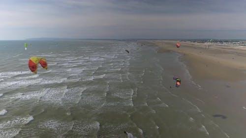 Flying Over Kitesurfers on a Beach