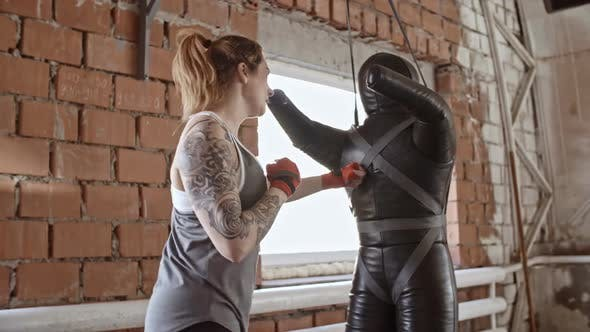Thumbnail for Woman Punching Dummy in Boxing Gym
