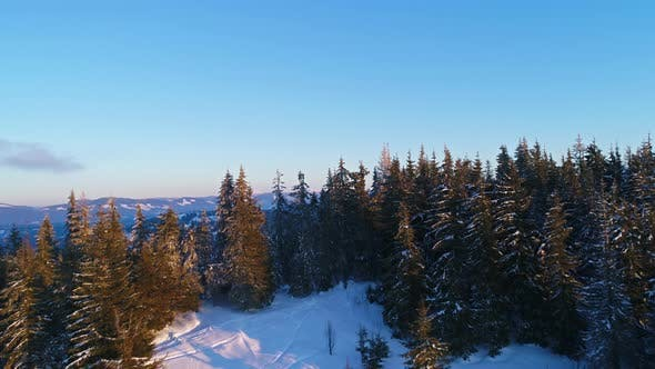Thumbnail for Flying Over Winterland, Mountain Snow Covered Winter Landscape