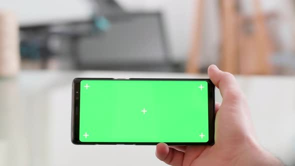 Thumbnail for Man Holding Horizontally a Smartphone with Green Screen on