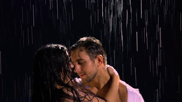 Love Story of Couple in the Rain Expressed in a Passionate Dance