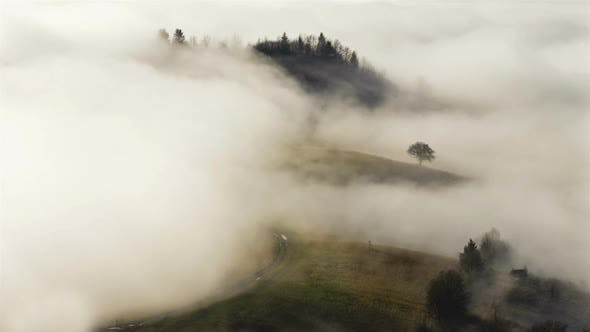 Thumbnail for Wave of Misty Clouds Covering Rural Country Landscape