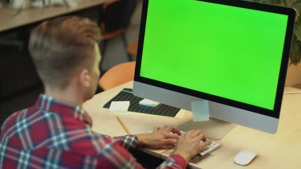 Thumbnail for Business Man Typing on Computer with Green Screen. Young Man Working on Computer
