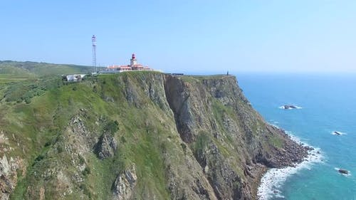 Sea view of lighthouse at Cabo da Roca cape, westernmost extent of mainland Portugal and continental