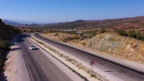 Aerial Drone View of the Country Asphalt Road in Mountains