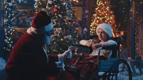 Thumbnail for Santa Claus Speaking with Girl on Wheelchair