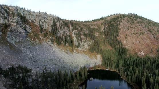 Flight Revealing Watch Lake in Rocky Forested Gypsy Ridge Area