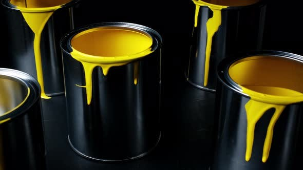 Thumbnail for Colorful Paint Leaking Down on Wall of Metal Bucket. Isolated Over Black Background. Shot on Slider