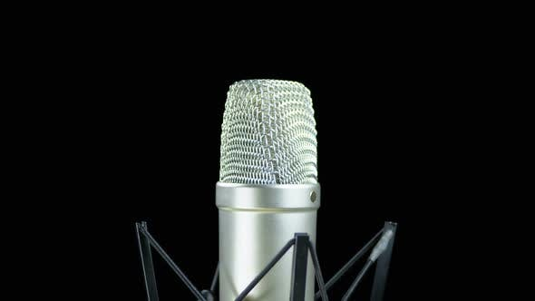 Thumbnail for Studio Microphone with Spider Rotates on a Black Background