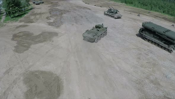 Flying Over Military Vehicles on Shooting Ground