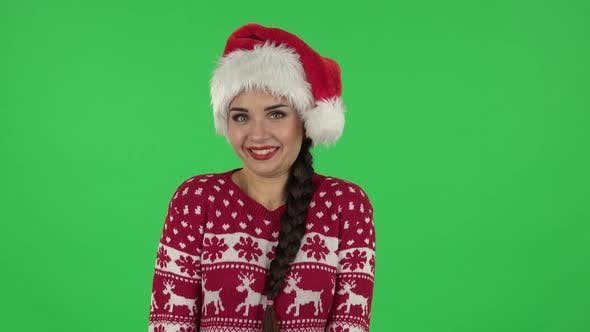Thumbnail for Portrait of Sweety Girl in Santa Claus Hat Is Expressing She Innocent. Green Screen