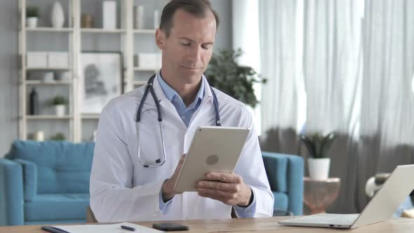 Thumbnail for Senior Doctor Using Tablet for Online information