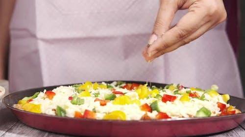 Young Women Making Pizza