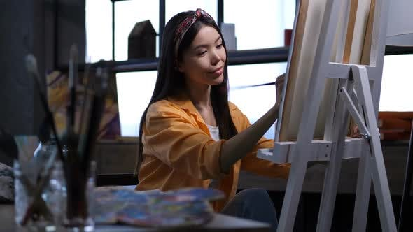 Thumbnail for Female Artist Making a Painting at Art Studio