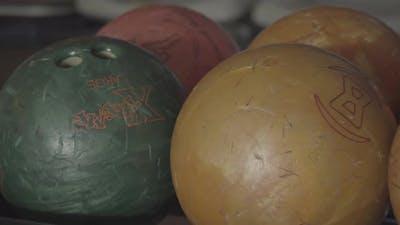 Bowling balls on a ball rack