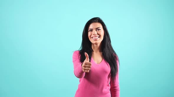 Thumbnail for Portrait of Stylish Woman in Pink Jumper Showing Thumb Up