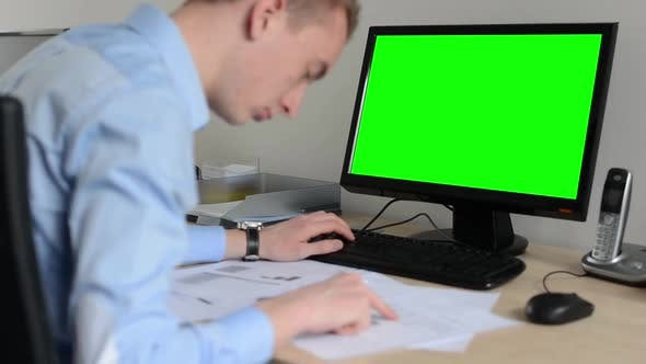 Thumbnail for Man Works on Desktop Computer in the Office - Typing on Keyboard - Green Screen