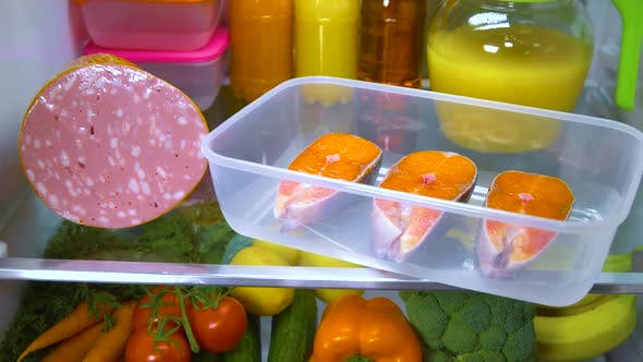 Thumbnail for Raw Salmon Steak in the Open Refrigerator