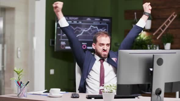 Thumbnail for Happy and Excited Businessman in Modern Looking Office
