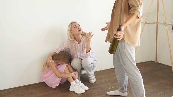 Social Issues Abuse and Aggression on Women and Child Sitting on the Floor