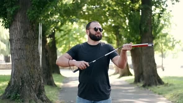 Thumbnail for Blind Bearded Man Preparing White Cane for a Walk