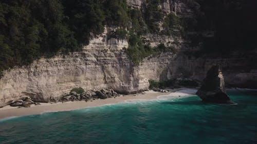 Aerial View of Rock in the Ocean on Virgin Suwehan Beach