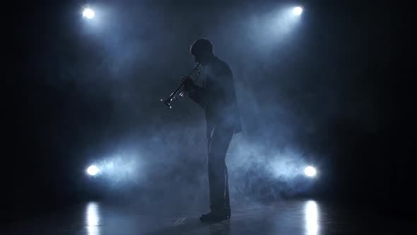 Thumbnail for Musician in a Smoky Studio Playing in a Trumpet