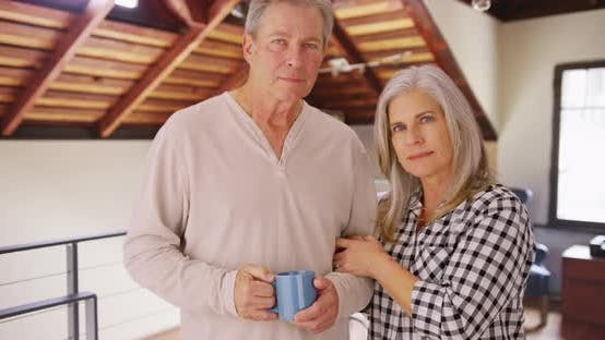 Thumbnail for Charming mature white couple looking serious