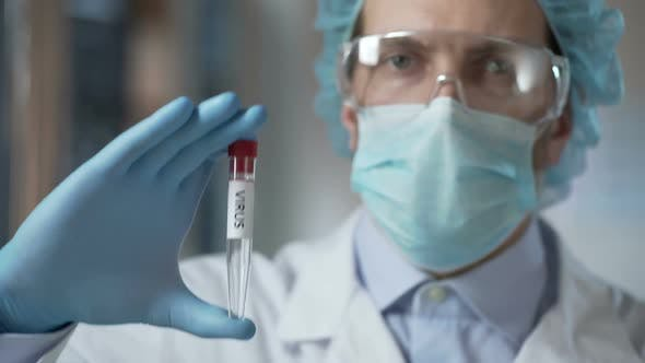 Thumbnail for Disease Control Lab Assistant Studying Strains of Virus for Invention of Vaccine