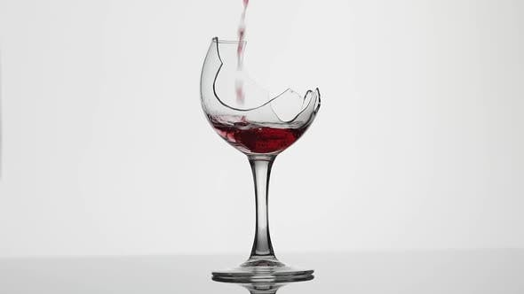 Thumbnail for Wine. Red Wine Pouring in Broken Wine Glass on the White Background