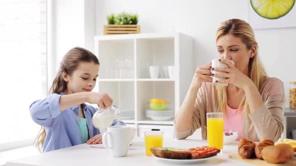 Thumbnail for Happy Family Having Breakfast at Home Kitchen 37