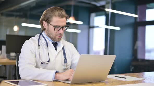 Thumbnail for Doctor Talking with Patient Via Video Chat on Laptop