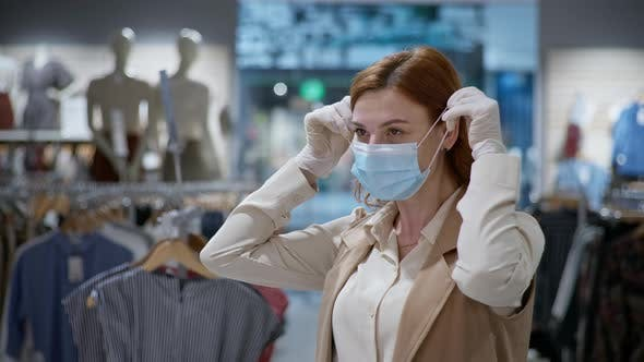 Thumbnail for Purchase in Coronavirus, Happy Female Customer in Medical Gloves Putting on Face Mask To Protect