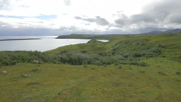 Thumbnail for Panoramic view of a green field on a coastline