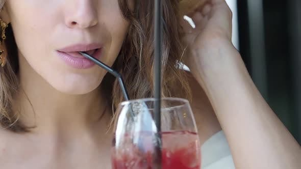 Thumbnail for Close Up Lips of a Woman Drinking Coctail.