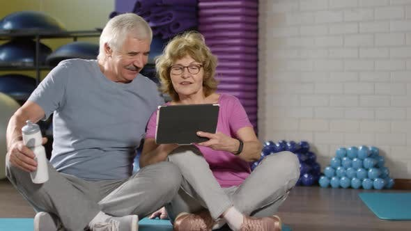 Thumbnail for Seniors Using Tablet in Sports Hall