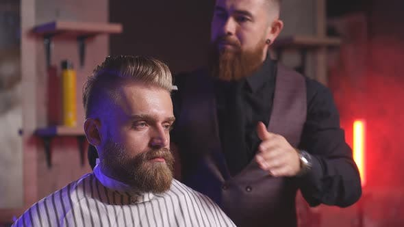 Hairdresser Makes Hairstyle for a Stylish Man