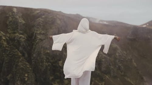 Medium Shot of a Person Feeling the Wind on Top Of a Mountain